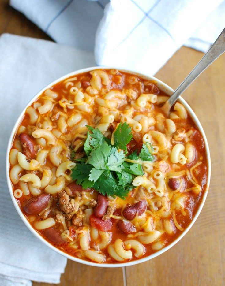 Crock-Pot® Turkey Chili Mac and Cheese is the ultimate cold weather comfort food, perfect for dinner or game day. Turkey Chili is slowly simmers in a Crock-Pot® and then pasta and cheese are mixed in when it is ready to eat. This is a family favorite! // A Cedar Spoon