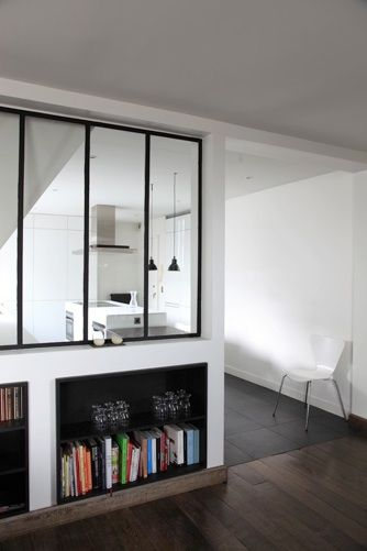 Cool idea to create the feel of open plan when you cannot pull down walls - bi fold window