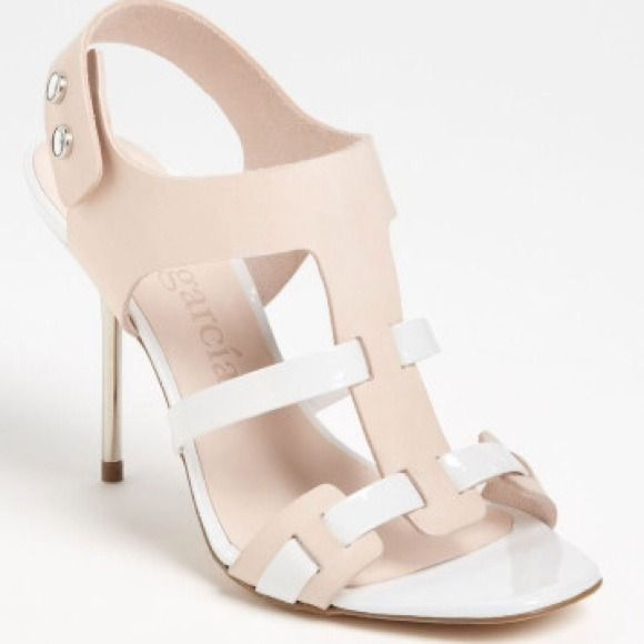 "Pedro Garcia White Woven Mika Sandal 9.5 NWT Pedro Garcia White Mika Sandal has a slim metallic heel that underscores the modern minimalism of a woven sandal softened w/ muted hues.  Approx. Heel height 3 1/2"" Snap-strap closure 9 1/2 NWT & box.h n. Bbu Pedro Garcia Shoes"