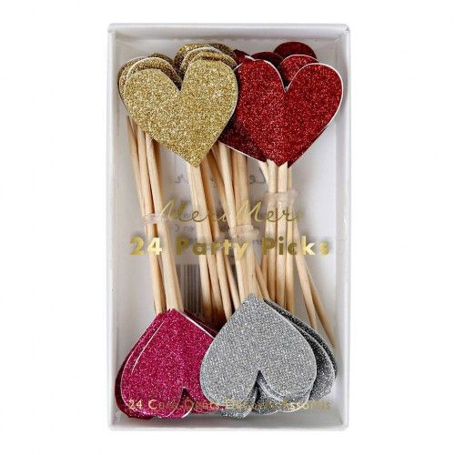 Love Heart Food Toppers Add heaps of love and sparkle to your cakes, canapés and cocktails with these super cute glittery food toppers. Each pack contains 24 heart shaped glittery toppers in red, pink, gold and silver - plenty of love to be shared. They are made from glittery card and wooden sticks. #valentinesday #valentines #valentine #cake #caketoppers #hearts #love #heart #glitter #party #partydecor #romantic #wedding #postboxparty
