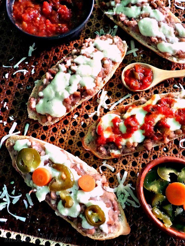 Molletes (open-faced refried bean sandwiches)