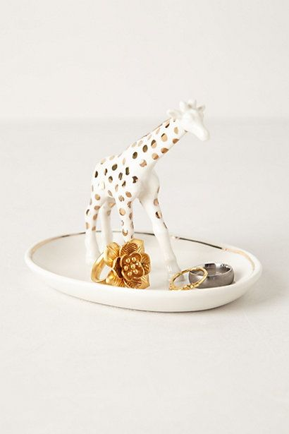 giraffe trinket dish. Plastic animal spray painted and added to a small plate or bowl.  Easy peasy.