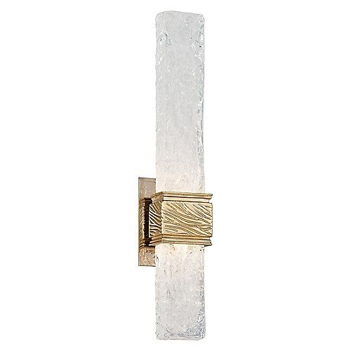 """The highly conceptual look of the Freeze Wall Sconce from Corbett Lighting .creates an atmosphere in any space. It features a custom hand-crafted Venetian Glass squared rod diffuser with a wavy, frozen aesthetic. This accent is paired with a Gold Leaf finished square holder and matching backplate for a cool and contemporary look. 21.38""""Hx4.75""""Wx3.5""""D.  12W LED, 840 lumens, CRI 90, 2700K.  Dimmable?"""