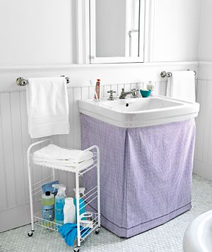 The Bathroom * Glide a sticky lint roller over the bath mat to pick up hair.* Light a candle. Everything looks better (and cleaner) by candlelight.  * Hang a fluffy bathrobe on top of damp towels dangling from the hooks     * Hang fresh guest towels. The humidity in this room makes textiles look droopy, even after a recent machine washing.     * Mound cosmetics and hairstyling products in a container underneath the sink.