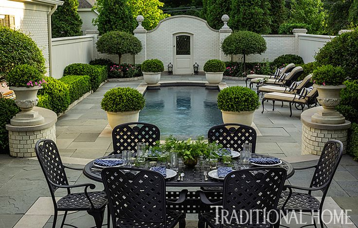 Bluestone pavers with limestone accents surround the pool and the dining terrace. - Photo: Bob Stefko / Design: Douglas Hoerr