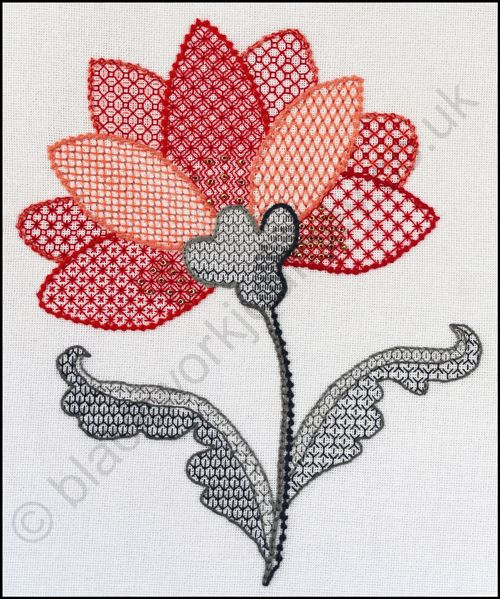 Pulled work and blackwork techniques combine to create Lakeshore Lily from Blackwork Journey. www.blackworkjourneyco.uk