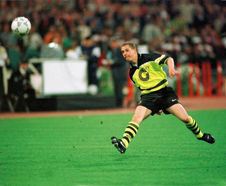 Substitute Lars Ricken scores a glorious chip with his first touch just seconds after coming off the bench to clinch the Champions League trophy for Dortmund against Juventus in 1997