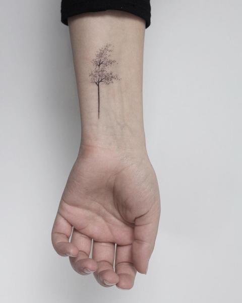 Hand poked windy tree tattoo by Lara M.J.