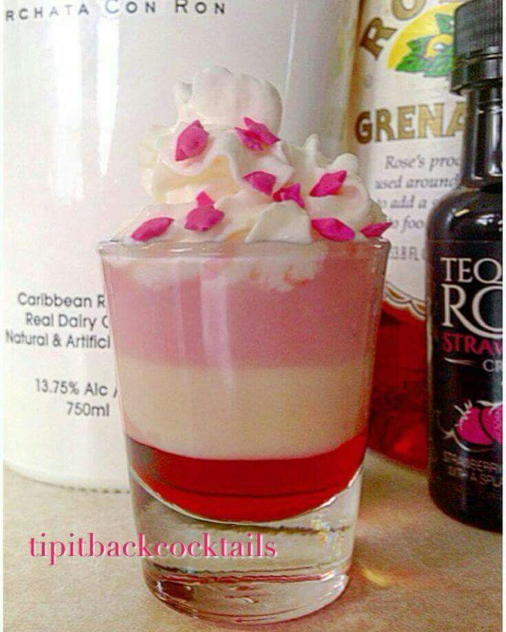 """French Kiss Shot Ingredients: 1/2 oz RumChata 1/2 oz Tequila Rose Strawberry Cream 1/2 oz Grenadine Garnish with: Whipped cream & pink sprinkles   Recipe info: https://www.instagram.com/p/8_UGRAxO2J/"