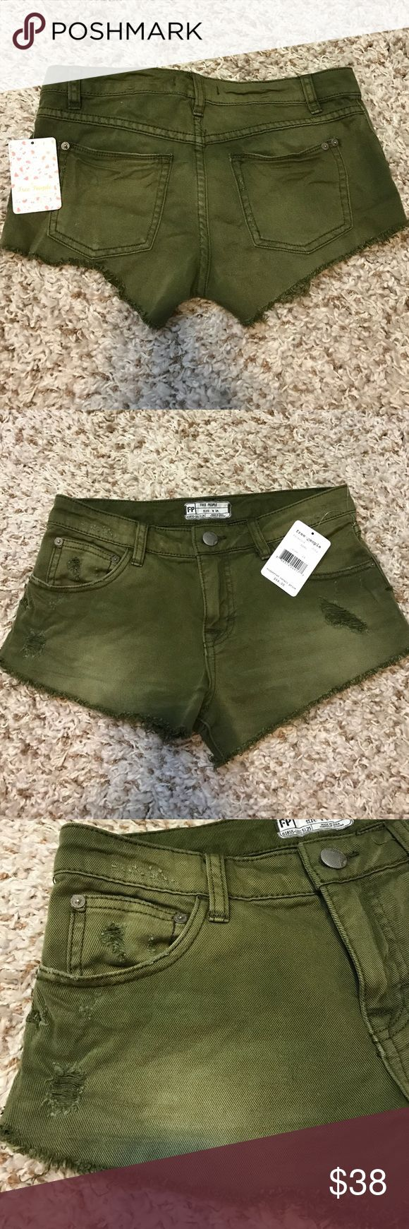 Free people Army shorts distressed NWT $68 Free People army green distressed mini shorts size24. 5 pocket style. Free People Shorts Jean Shorts