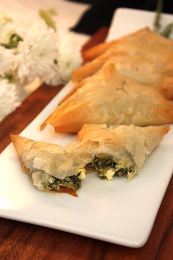 Spanakopita! How to roll triangles: http://greekfood.about.com/od ...