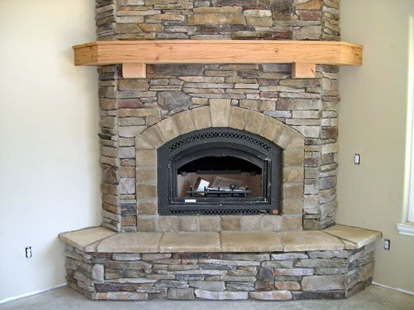 corner fireplace.  We're putting in a pellet stove, so I like the idea of creating a brick or stacked stone hearth/surround for it.  Hmmm??