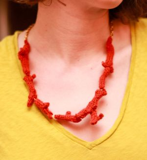 This beautiful red coral necklace was designed for Lion Brand by Kim Hamlin. #knitting #nature