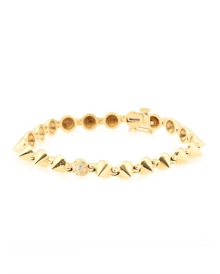 """Designed for and Exclusively Available at all Ron Herman store locations. Gold bracelet with single row of cone shaped spikes all the way around. Single white diamond spike in center.Measures 6.5"""" length 0.5"""" box clasp closure with security latch. Handmade in USA. *Please note there are no returns / exchanges on this item*ALL PIECES CAN BE ALTERED IN LENGTH & ARE AVAILABLE IN ROSE, WHITE OR YELLOW GOLD For more information Please Contact: Jason Miller at: Jason@RonHerman.com"""