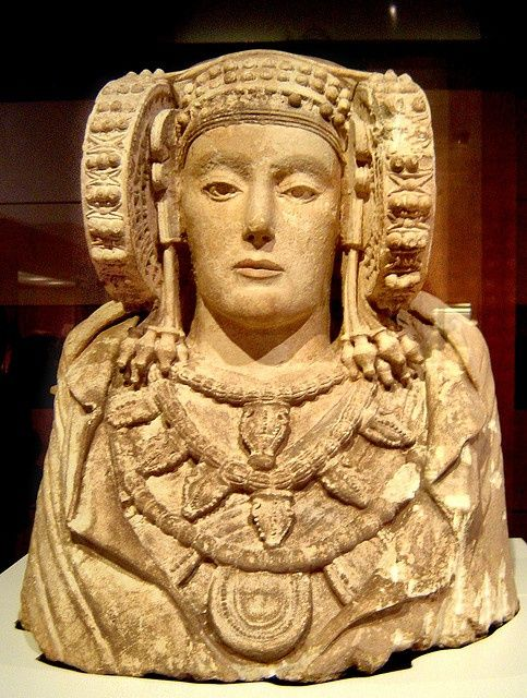 La Dama de Elche. The Lady of Elche is as once polychrome stone bust that was discovered by chance in 1897 at an archaelogical site about 2 km south of Elche, Alicante. The Lady of Elche is generally believed to be a piece of Iberian sculpture from the 4th century BC. According to the Encyclopedia of Religion, The Lady of Elche, is conjectured as having direct association with Tanit, the goddess of Carthage, that was worshiped by the Punic-Iberians.