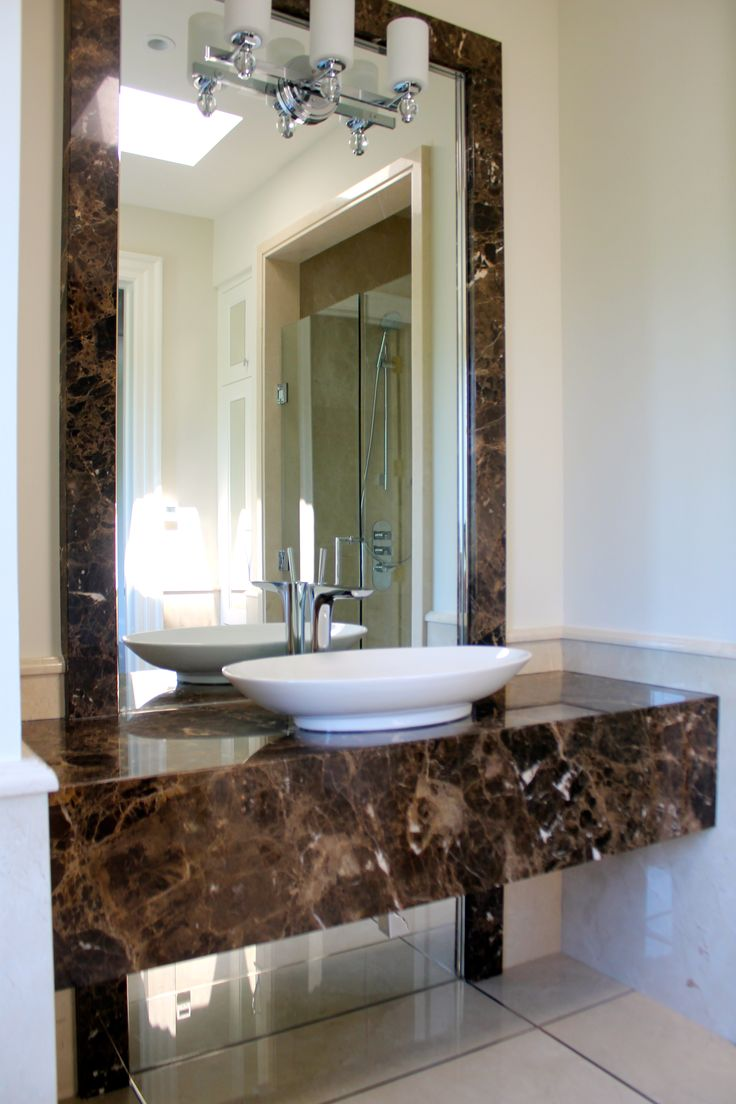 Free Standing Vanity With Topmount Vessel Sink And A Feature Trim Around The Mirror
