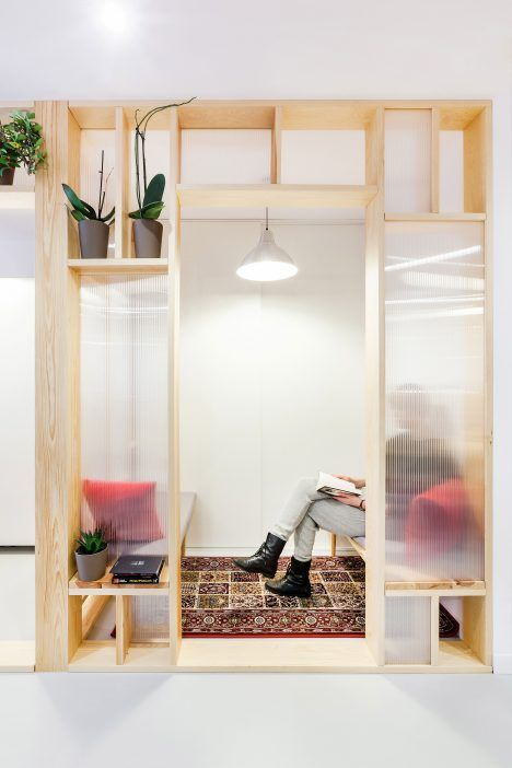 Economical workspace renovation in Warsaw by MFRMGR features semi-transparent…