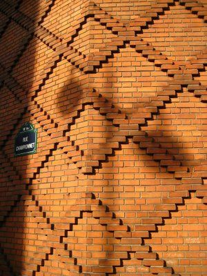 textured brick wall is an architectural example of modularity usage of the same material and - Brick Wall Design
