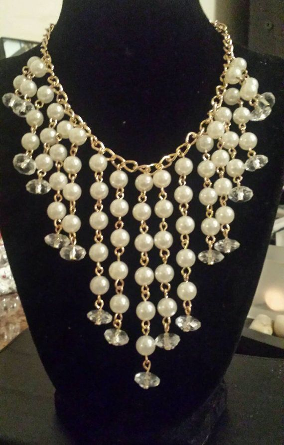 Check out this bib style pearl necklace in my Etsy shop https://www.etsy.com/listing/213768814/waterfall-pearls-necklace-imitation