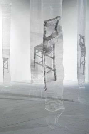 Ainsley Hillard. photographic images of objects such as chapel chairs, reading tables and books communicate a shared sense of history, an irrecoverable past. These images are transfigured into woven structures through a process of heat-transfer on to the transparent viscose weft prior to then being hand-woven through a nylon monofilament warp. The images, once woven into structural forms, connect with one another and once installed allow an overlapping fabric.