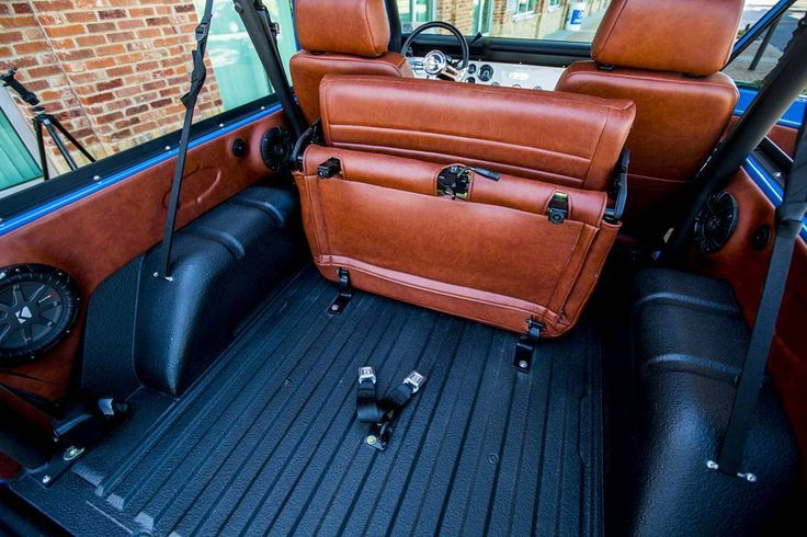 Velocity Restorations 76 Bronco.  Nice folding rear seat and side panels.