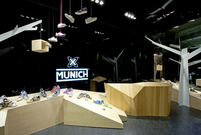 Munich Flagship Store - Barcelona Established by the Berneda family in 1939, Barcelona's own sports shoe house Munich continues to stay on top of things. In the 1970s, Munich made tracks with the Made in Barcelona footwear line and the X logo.