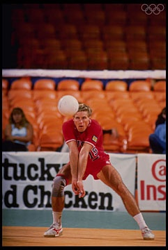 Aug 1984: Karch Kiraly of the USA bumps the ball during the USA v France match in the 1984 Summer Olympic Games in Los Angeles at the Long Beach Arena in Long Beach, California.