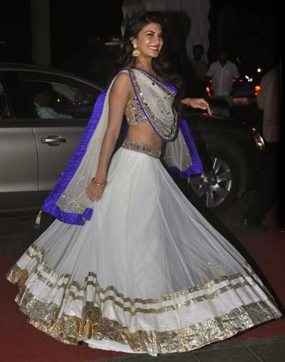 The beautiful actress, Jacqueline Fernandez, was a vision in a white and blue lehenga by Arpita Mehta. - bollywoodshaadis.com