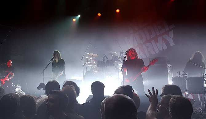 New Model Army live in Cologne New Model Army are an English rock band formed in Bradford, West Yorkshire in 1980 by lead singer, guitarist and main composer Justin Sullivan, bassist Stuart Morrow and drummer Phil Tompkins.... #Event #Music  #Tour #Backpackers #Tickets #Entertainment