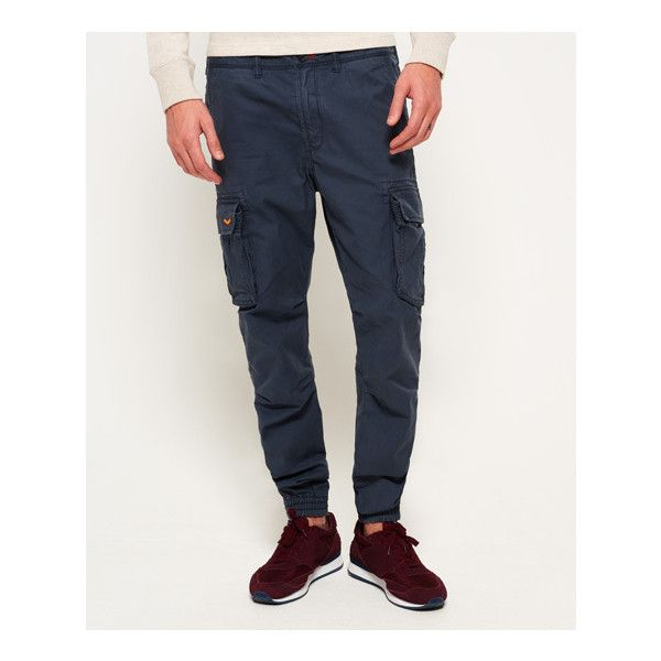 Superdry Rookie Grip Cargo Pants ($60) ❤ liked on Polyvore featuring men's fashion, men's clothing, men's pants, men's casual pants, blue, mens multi pocket cargo pants, mens military cargo pants, mens embroidered pants, mens navy blue cargo pants and mens pants
