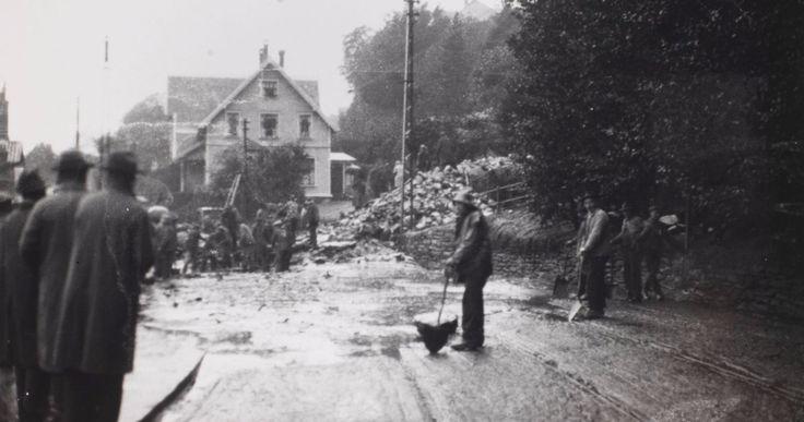 [Raset fra Fløyen 1930] Opprydding etter flommen og raset Ved Kalvedalsveien 6? Fotografi skapt av F. Tegner Laget mellom 1930-10-01 og 1930-10-31 Signatur: ubb-bs-ok-04173-006