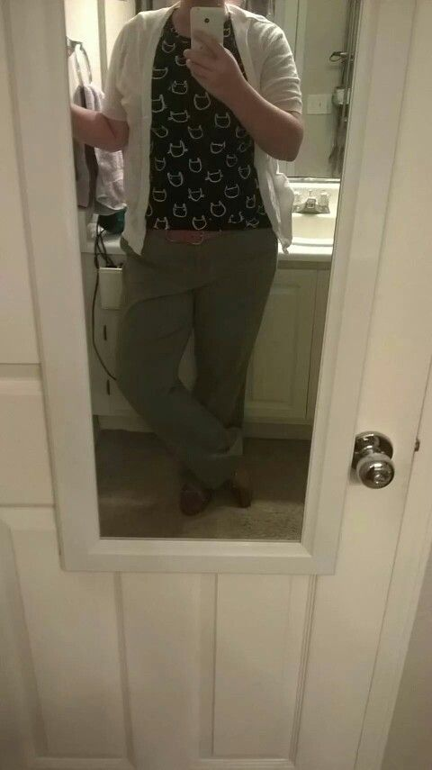 Cat tee-shirt, olive chinos, white short sleeve cardigan, tan belt and Clark's tan deck shoes.