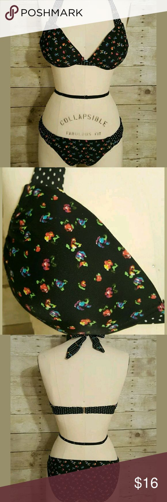 Xhilaration Black Floral Bikini Xhilaration two-piece bikini in black with multi-color floral print and polka dot accents.  Top is padded and has underwires, halter tie neck, hook clip back. Bottoms are standard bikini brief.  Top and bottom are size small. Tags from top have been cut out.  Pre-owned, excellent condition, no rips or stains. Xhilaration Swim Bikinis