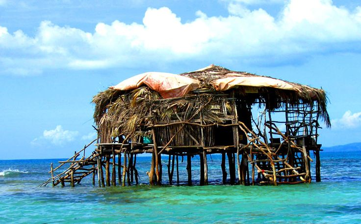 Talk about a sand bar! This is a wooden structure off the South Coast of Jamaica, about 2 miles out to sea. The Pelican Bar.