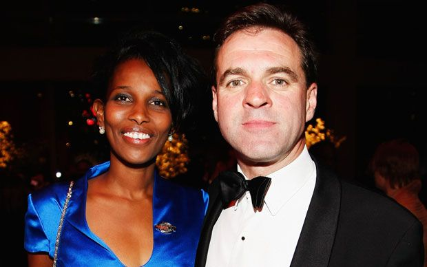 Niall Ferguson, the television historian, has married Ayaan Hirsi Ali, the   target of Muslim extremists, in an American ceremony attended by Henry   Kissinger.