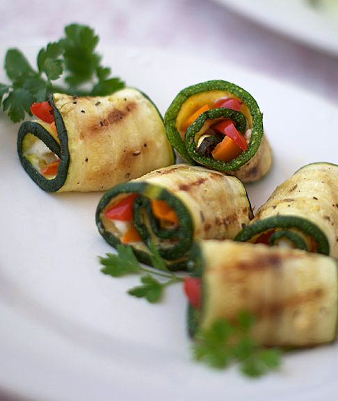 Perfect for appetizers... grilled zucchini roll-ups with herb cream cheese and fresh veggies