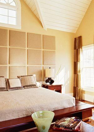 DIY headboard - upholstered squares with natural fabrics...like this one but not sure if it could work with our setup (bed partially in front of a window)