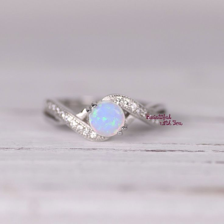 Womens Sterling Silver White Opal Ring, Silver Opal Ring,Lap Created Opal Ring with Cubic Zirconia,Promise Ring for Her,Opal Engagement Ring by BeautifulWithYou on Etsy https://www.etsy.com/listing/253009510/womens-sterling-silver-white-opal-ring
