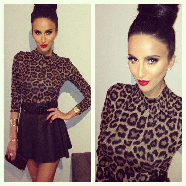 leopard top, leather skirt, donut bun