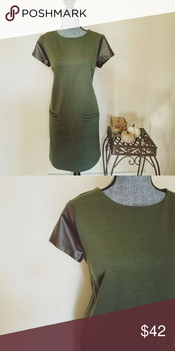 🎉HP🎉 Tommy Hilfiger Army Green Shift Dress Absolutely stunning & slim fitting dress. | This could also fit a medium, I believe with a more looser fit. | Very slim fitting & beautiful | Faux leather sleeves & 2 front pockets (LOVE the pockets!). | Zipper on back. | This us a shift dress so it shapes to your body form. | Absolutely perfect condition. | Reminder - My prices are set to negotiate 💕  Armpit to armpit measures about 20.5 inches long. Length from shoulder to hemline measures…