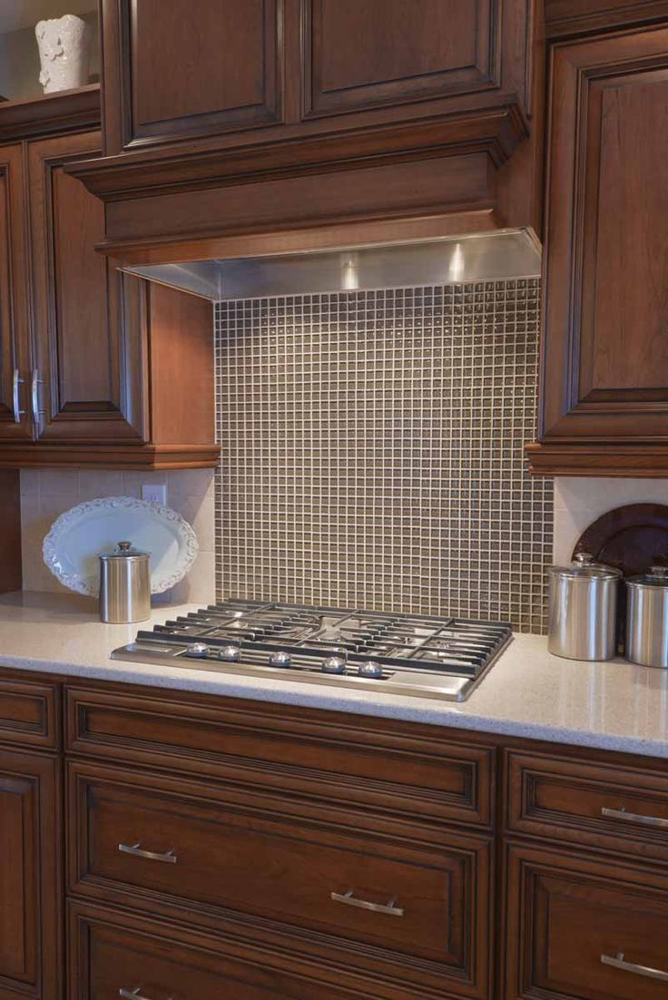 Rich Wood Cabinets And A Bright Glass Backsplash Great Combo