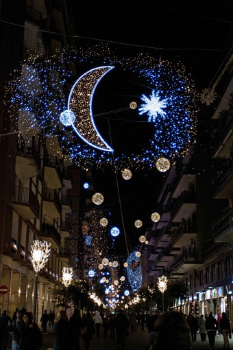 """Photo taken on November 17, 2012 shows Christmas lights illuminating the streets of downtown Salerno, southern Italy, part of an exhibition called """"Artist' lights"""" created by several Italian artists."""