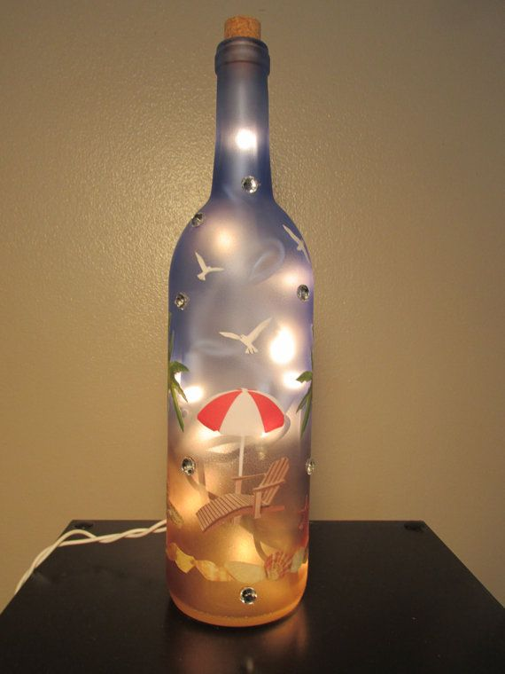 Beach Wine Bottle Night Light. Strand of 20 mini lights inside. Hole drilled in back of bottle for cord. Images on the night light are mounted
