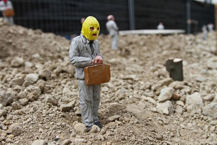 isaac cordal miniatures address the collapse of capitalism