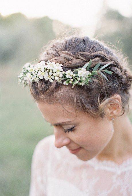 We love the simplicity of a braided crown for a spring or summer wedding. The addition of a dainty floral headband is so romantic, and can be customiz...