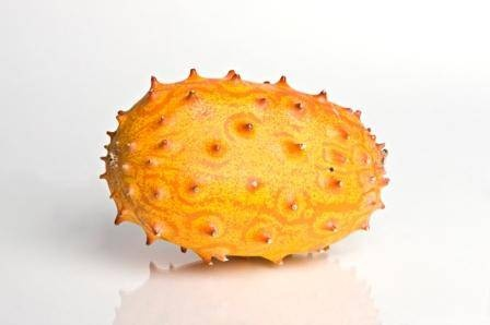 Kiwano - Also known as the Horned Mellon.  This is an odd fruit that is orange and yellow and has spikes on the skin of the fruit. The inside is a bright green. Cut open and eat green flesh off of the seeds.
