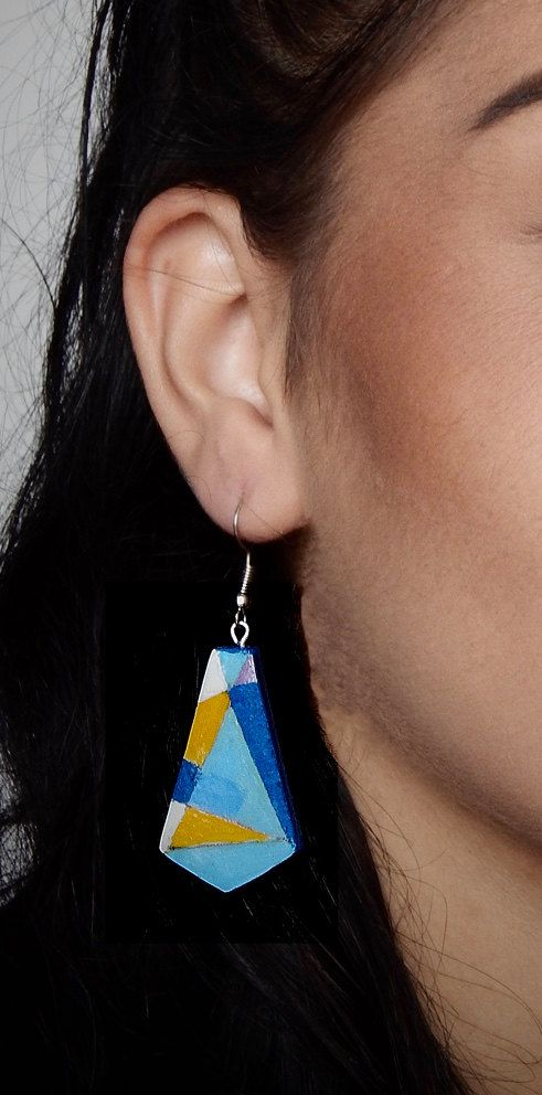 """I was inspired by abstract and geometric art to create these special ceramic earrings and hand-painted.    In these triangle earrings the color is yellow, blue, violet color  Materials: Ceramic, acrylic, glaze, transparent finish.    They measure about 3 cm (1.2 inch)    They are very lightweight    If you want a different color please contact me    Uniqueness and wonderful imperfection of """"handmade""""  In a time when everything, in order to exist and compete, seems to have to be done on a…"""