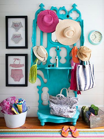 Foyer - Teal paint juices up an old hall tree. Hooks, shelves, and baskets are ideal for corralling beach essentials. An entryway that can house hats, towels, sunscreen, and more keeps these items from creating clutter in the rest of the house.  Get the Look: Frame clothing for budget-friendly artwork. Here, vintage swimwear adds to the cottage's 1940s charm.