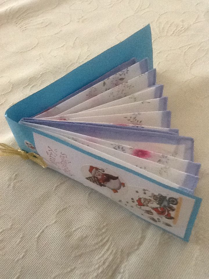 Handkerchief folded into a fan shape and ends glued into hand made card