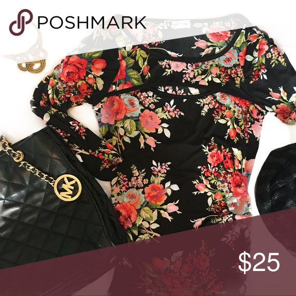 SEXY body central fall floral long sleeve tee Super sexy ruched (for super flattering fit) stretchy body central long sleeve top! Stunning floral print gorgeous reds for this fall 🤗🍁🍂❤️ sexy slit across bust. Medium, very good condition! Paired with stunning gold tone necklace also from my closet! Bundle and save 10 percent ❤️✨🤗 Body Central Tops